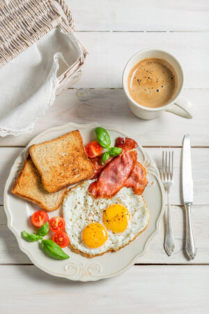 Eggs, toast and bacon for breakfast photo
