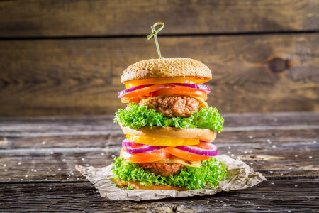Double-decker burger made from vegetables and beef photo