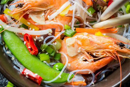 Vegetables served with prawns and noodles photo