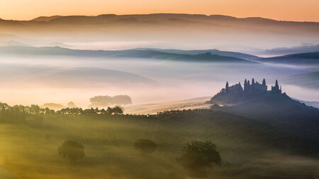 Sunrise over the valley of olive groves and vines photo