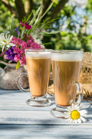 Coffee in the sunny summer garden photo
