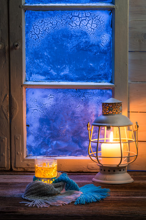 snow scene: Hot tea in cold winter evening