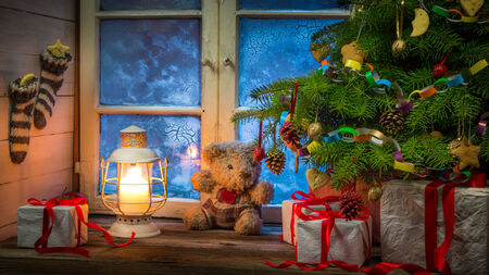 Christmas rural cottage in frosty evening photo
