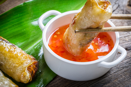 chinese cuisine: Fried spring rolls serves with sweet and sour sauce Stock Photo