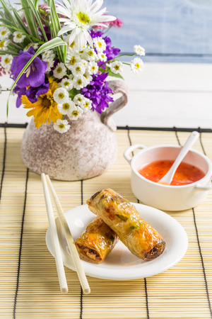 Spring rolls with sweet and sour sauce photo