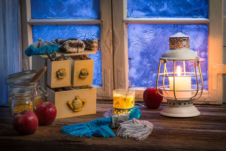Warming tea in a winter cottage photo
