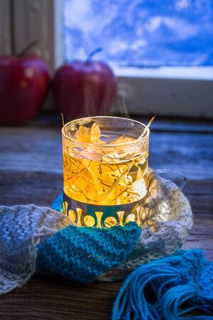 Glass full of linden warming tea photo