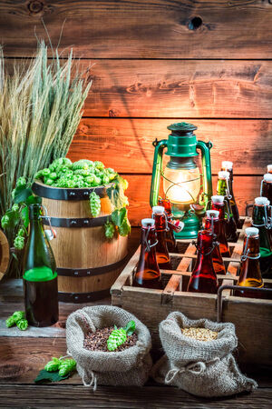 Ingredients for beer and bottles in the cellar photo