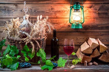 demijohn: Homemade red wine stored in the cellar Stock Photo