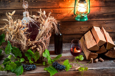 red oil lamp: Homemade red wine in a wicker basket