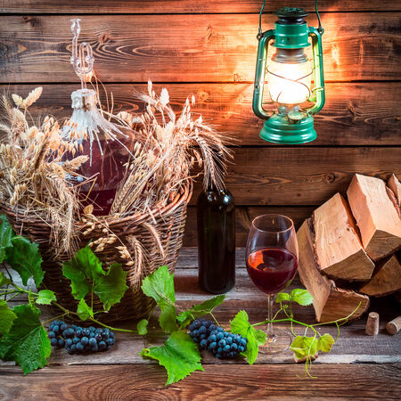 red oil lamp: Homemade winery in cellar