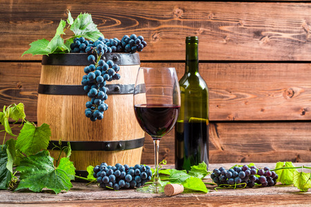red oil lamp: Red wine and grapes in a barrel