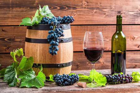 Red wine and grapes photo