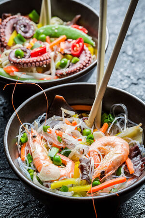 Seafood and vegetables served with noodles photo