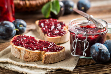 Closeup of sandwich with fresh plum jam photo