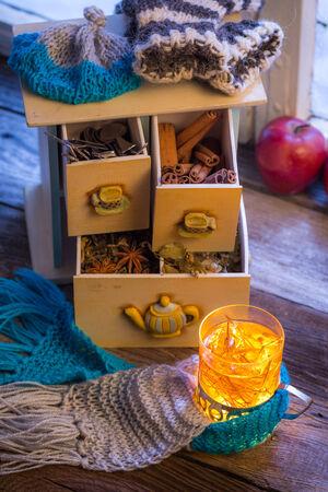 Enjoy your warming tea in winter evening photo