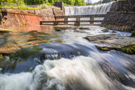 creates: Stone dam creates a mountain waterfall