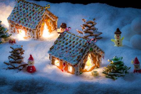 Gingerbread home with snowman and santa Archivio Fotografico