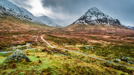 highlands region: Footpath between snowy mountains
