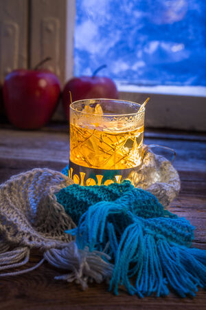 Hot tea in cold evening photo