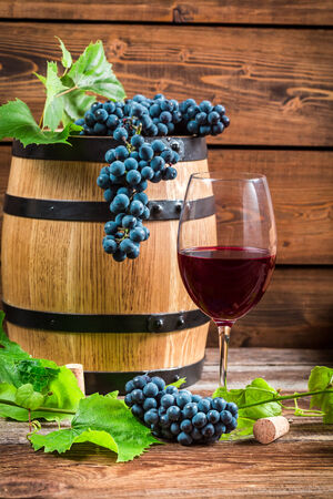 Glass of red wine and grapes photo