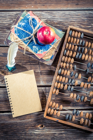 Old abacus and notes on math classes photo