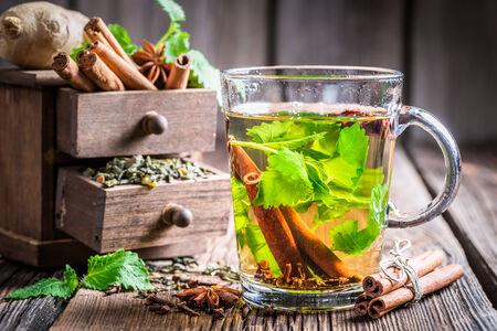 Hot tea with cinnamon and cloves photo