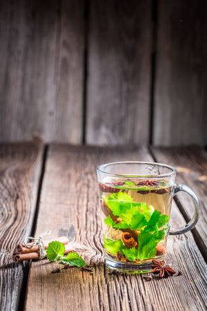 Hot green tea on a wooden table photo