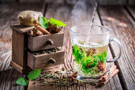Brewing green tea with cinnamon photo