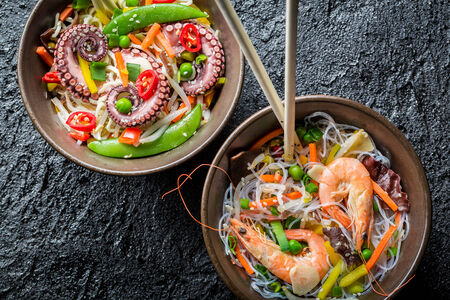 rustic food: Chinese noodles with vegetables and seafood Stock Photo
