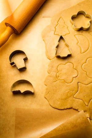 Closeup cutting of gingerbread cookies photo