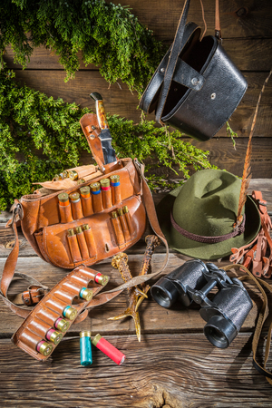 Bag, bullets and hat in a hunting lodge photo