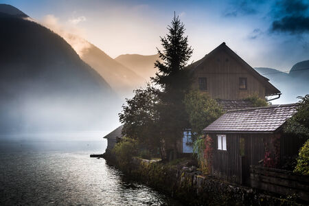 Small cottage in the misty mountains