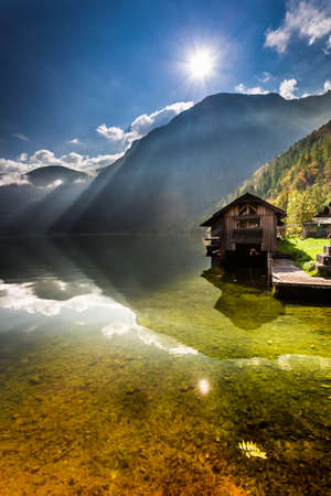 Old wooden haven at mountain lake