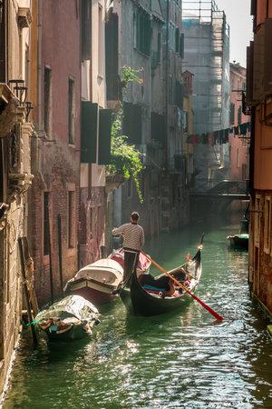 Lone gondolier in Venice Floating