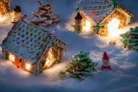 Small gingerbread houses in the snow photo