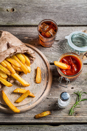 food and drinks: Fresh french fries served with cold drink Stock Photo