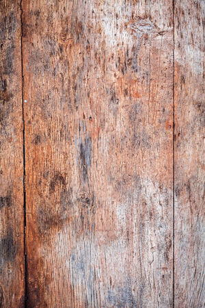 Old wooden background with nails and cracks photo