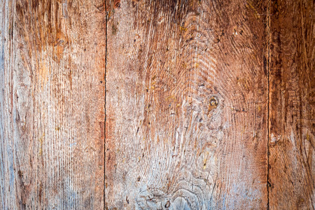 Old wooden background with and cracks photo