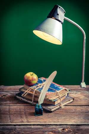 Vintage lamp and books in the classroom photo