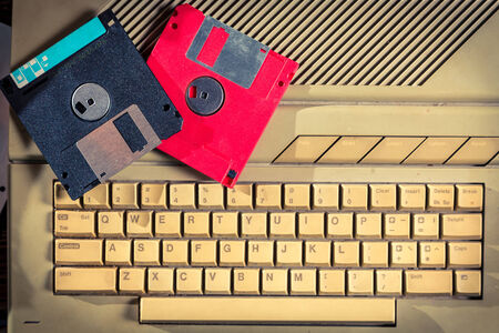 Vintage floppy disks and keyboard