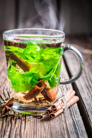 Hot tea with cinnamon and ginger photo