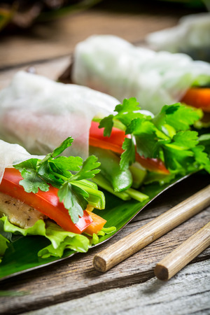 person appetizer: Spring rolls with vegetables and chicken Stock Photo