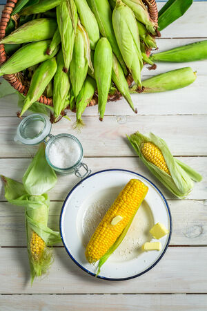Fresh hot corn served with butter photo