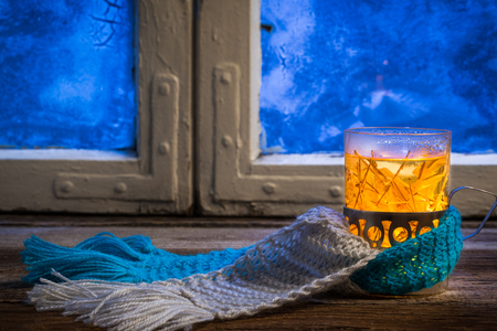 Winter evening and hot tea photo