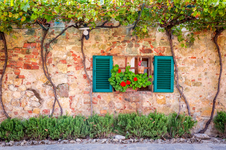 courtyard: Beautiful porch decorated with flowers in italy Stock Photo