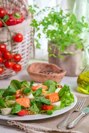 Healthy salad with salmon photo