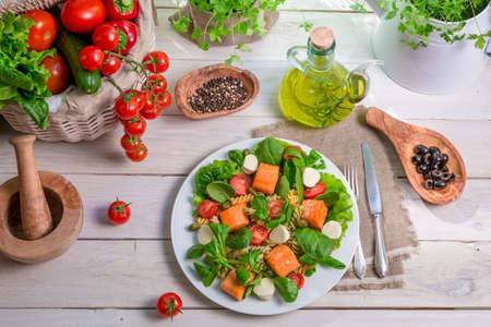 Fresh vegetables and salmon as ingredients for salad photo