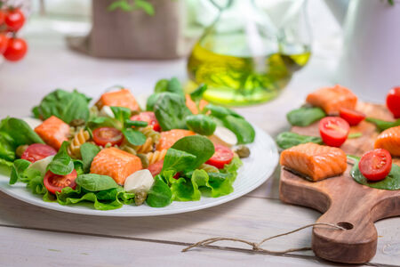 lite food: Closeup of salad with fresh vegetables and salmon
