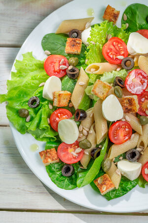 lite food: Salad with fresh vegetables and pasta Stock Photo